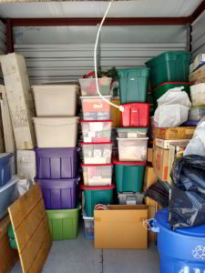containers stacked high in storage facility